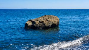 Rock in the water at Koloumbos Beach