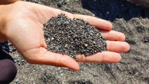 Black, volcanic sand on Kamaria Beach