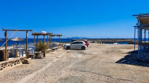 Parking area by the restaurant on Vourvoulos Beach